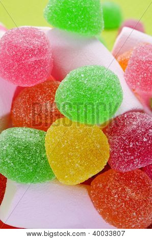 closeup of a pile of pink marshmallows and gumdrops of different colors