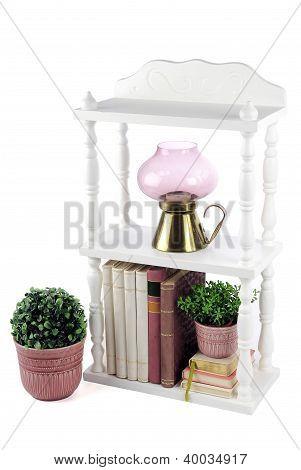 A small white bookcase