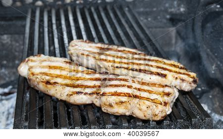 cooking catfish meat on the grill