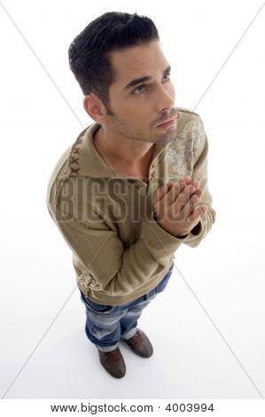 Man Praying And Looking Upwards