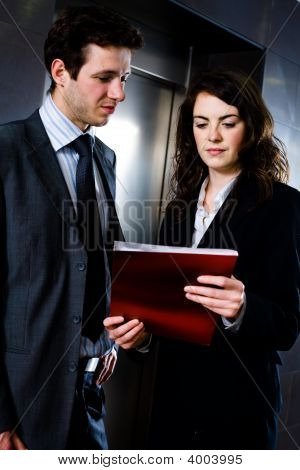 Businesspeople Reading Documents