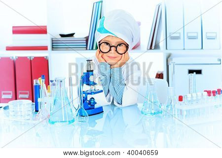 Cute boy is making science experiments in a laboratory. Education.