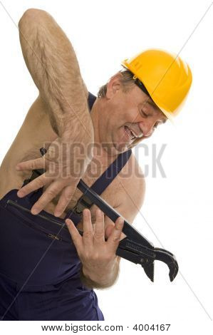 Plumber With Pipe Wrench And Safety Helmet