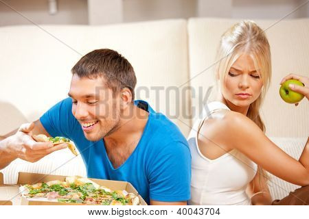 bright picture of couple eating different food (focus on man)