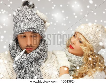 bright picture of family couple with thermometer