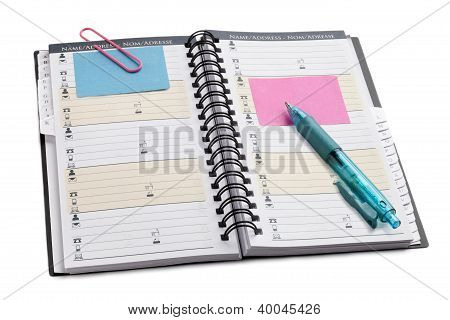 Open Notebook With Writing Instrument