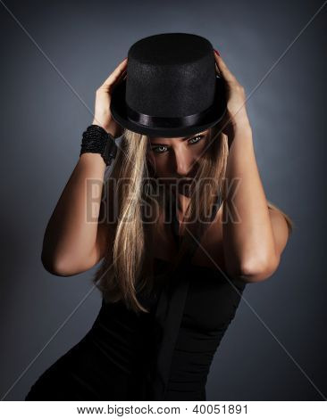 Photo of attractive woman wearing black stylish hat and tie, gorgeous female in retro headwear isolated on gray background, fashionable accessory, vintage vogue, New Year party, Christmas eve