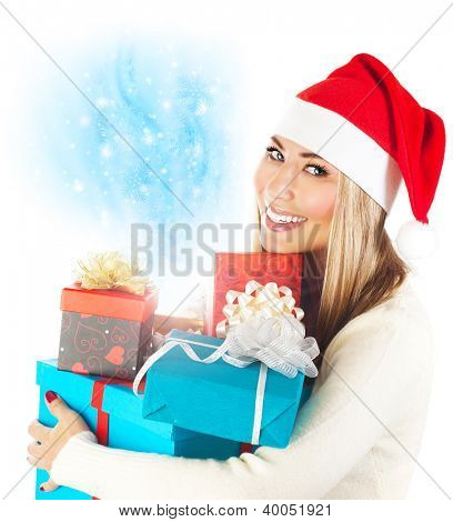 Photo of pretty Santa Claus woman, wearing red hat, holding many present boxes, beautiful girl received Christmas gifts, happy young lady isolated on white background, winter holidays celebration