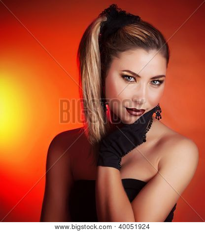 Image of beautiful girl isolated on red background with bright yellow light, closeup portrait of gorgeous woman wearing fashionable accessories, New Year party, Christmas masquerade