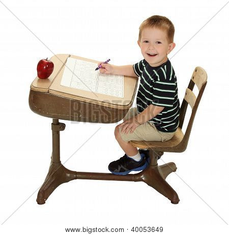 Grade School Student At His Desk