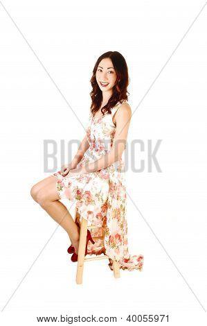 Girl In Dress Sitting.