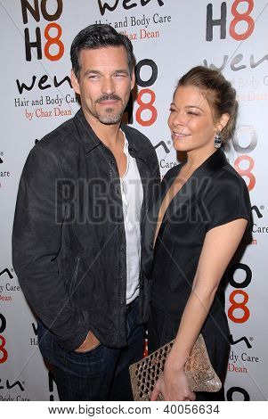 LOS ANGELES - DEC 12:  Eddie Cibrian, LeAnn Rimes arrive to the NOH8 4th Anniversary Party at Avalon on December 12, 2012 in Los Angeles, CA