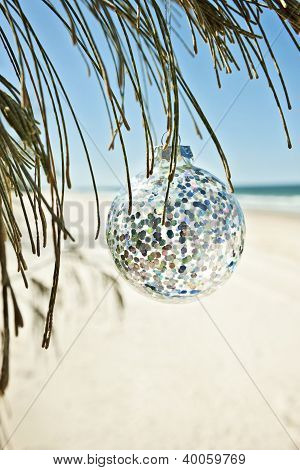 xmas ball hangs from a tree, summer christmas!