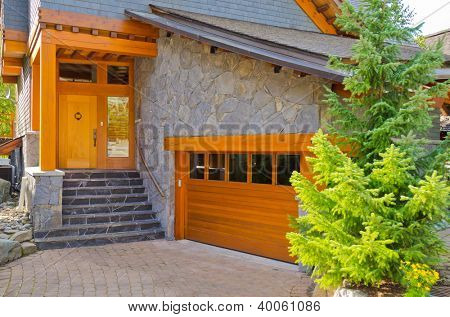 Fragment of a luxury house with a garage door in Whistler, Canada.