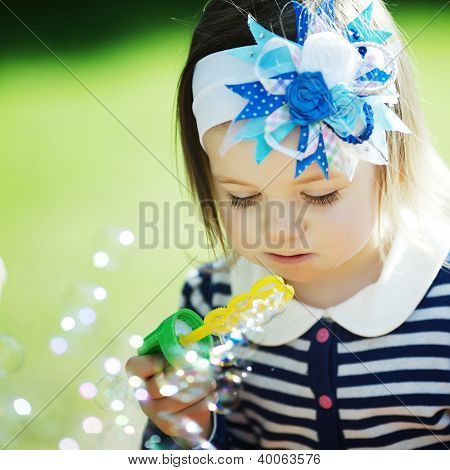 Little Funny Girl Plays With Bubbles