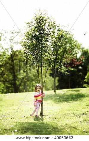 Little Happy Girl Near The Tree