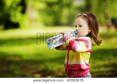 Little Girl Drinks Mineral Water