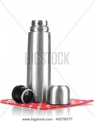 metal thermos on napkin isolated on white