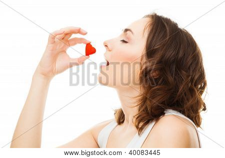 Young Woman Eatting Candy Heart Isolated