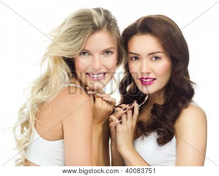 portrait of two attractive  caucasian smiling women blond  and brunette isolated on white studio shot  toothy smile face long hair head and shoulders looking at camera