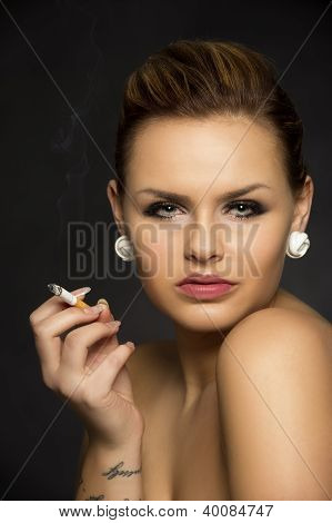 Beautiful Seductive Woman Smoking