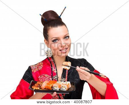 Woman Wearing A Traditional Red Dress Eating Sushi