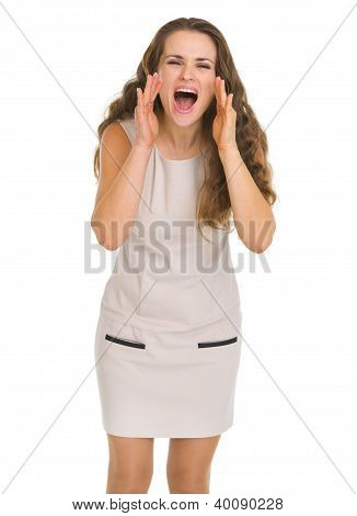 Young Woman Shouting Through Megaphone Shaped Hands
