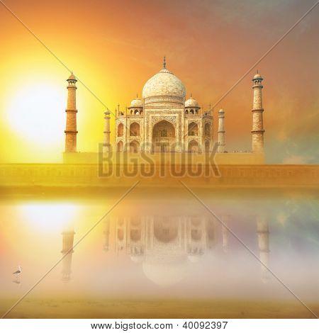 Taj Mahal India Sunset. Agra, Uttar Pradesh. Beautiful Palace with reflection in river. Wonderful landscape.