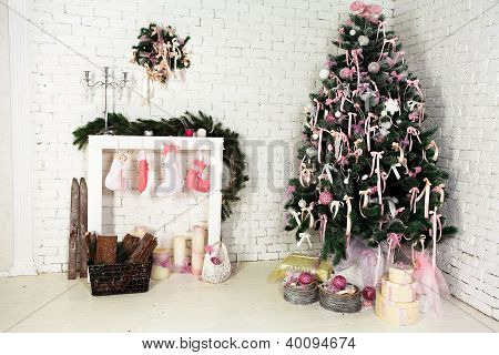 Christmas interior with a fir tree, fireplace and gifts