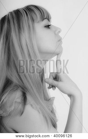 Studio Portrait Of Young Pensive Woman In Profile