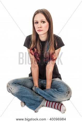 The Girl In Striped Socks Sits On The Floor With His Legs Crossed