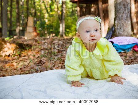 little beautiful baby girl in autumn park
