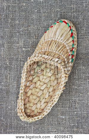 Wicker Bast Shoe On Linen Fabric