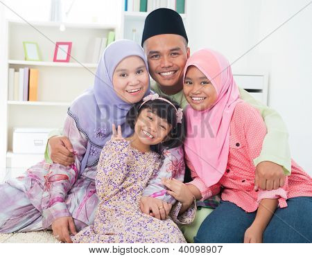 Southeast Asian family quality time at home. Muslim family living lifestyle.