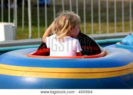 Toddler In Bumper Boat