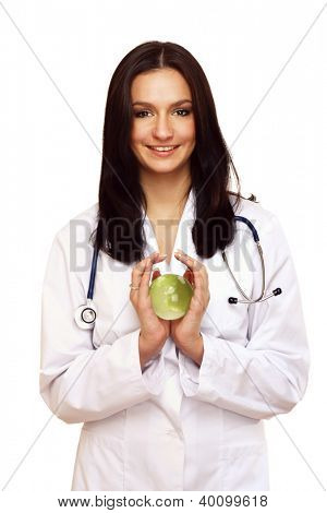 Close-up of green glass globe in doctor's hands isolated on white