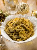 stock photo of carbonara  - spaghetti carbonara with artichoke on christmas table - JPG