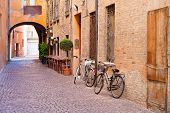 stock photo of ferrara  - old small stone medieval street in historical center of Ferrara Italy - JPG