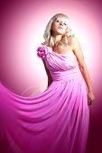stock photo of barbie  - Beautiful young woman in a pink silk cloth - JPG