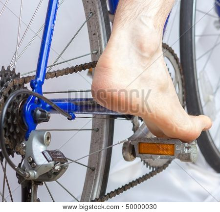Riding A Bike With Bare Foot.