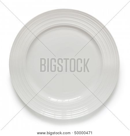White plate isolated on white with soft shadow.  Overhead view.