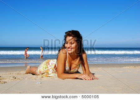 Beautiful Girl Lying On The Beach
