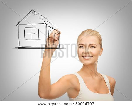 real estate, technology and accomodation concept - woman drawing house on virtual screen