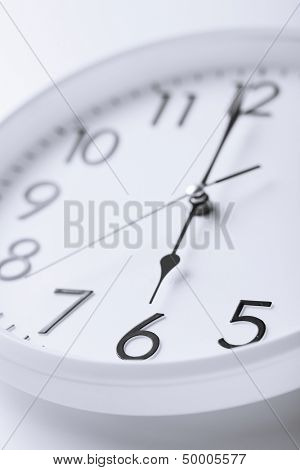 business and time concept - white clock showing six o'clock
