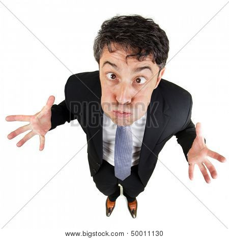 Frustrated man holding his breath and wringing his hands in desperation as he standing looking up at the camera with bulging eyes, fun high angle portrait isolated on white
