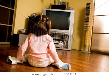 Cartoon Girl Sitting On The Floor. Keywords: girl happy. Watching