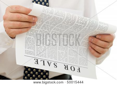 Businessman Reading Sales Ads