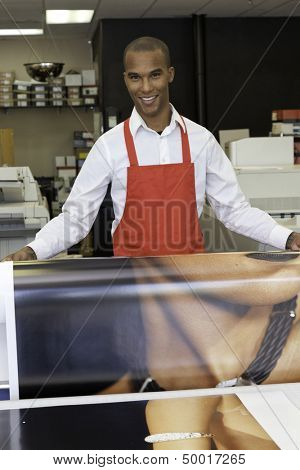 Industrial worker taking printouts