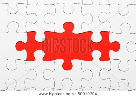 Incomplete puzzle in red color