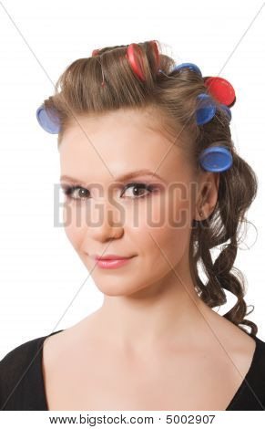 Portrait Of Young Female With Hairrollers Isolated